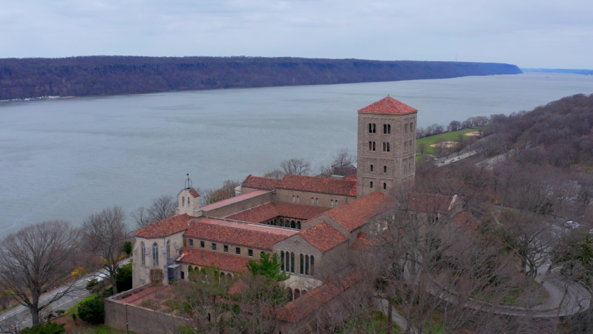 Aerial drone shot over The Cloisters museum at Fort Tryon Park on Manhattan Island, New York | Shutterstock HD Video #1070792245