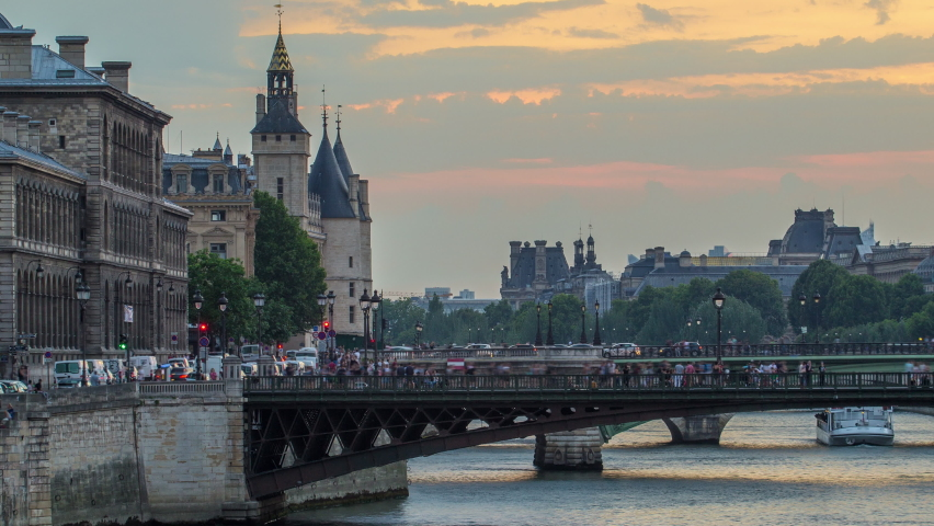 Le Pont D'Arcole bridge after sunset with people and boats day to night transition timelapse, Paris, France, Europe. Colorful sky at summer day with reflection on river Seine | Shutterstock HD Video #1070794975