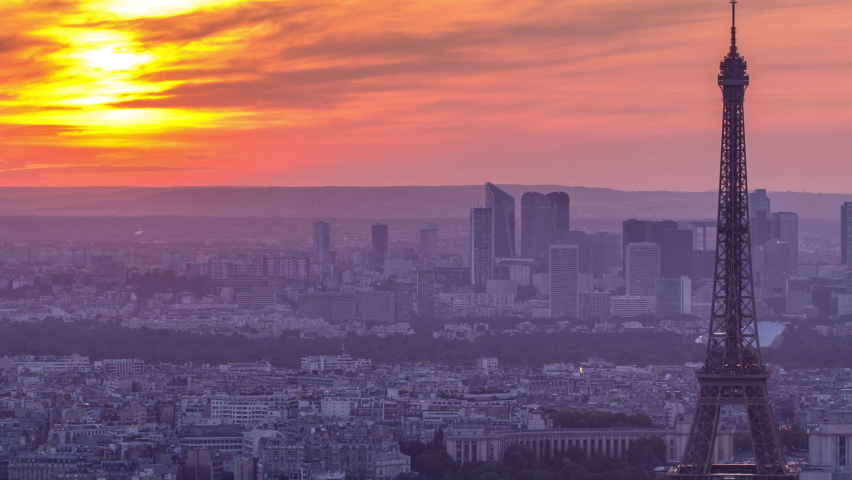 Panorama of Paris at sunset timelapse. Eiffel tower view from observation deck of montparnasse building in Paris - France. Colorful sky at summer day | Shutterstock HD Video #1070795083
