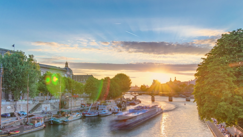 View to Pont des Arts in Paris at sunset timelapse from Pont Neuf, France. Ship on the River Seine near square of the Vert-Galant | Shutterstock HD Video #1070795209