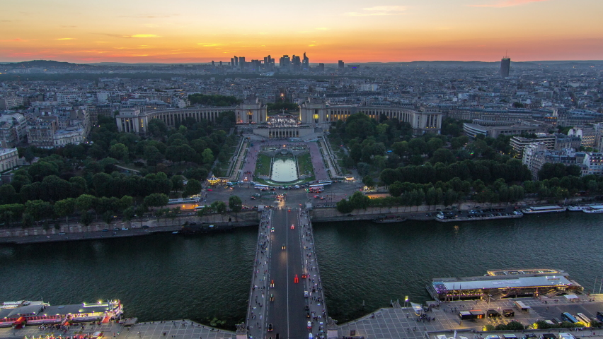 Aerial view over Trocadero day to night transition timelapse with the Palais de Chaillot seen from the Eiffel Tower in Paris, France. Top view from observation deck with river Seine and ship crossing | Shutterstock HD Video #1070795224