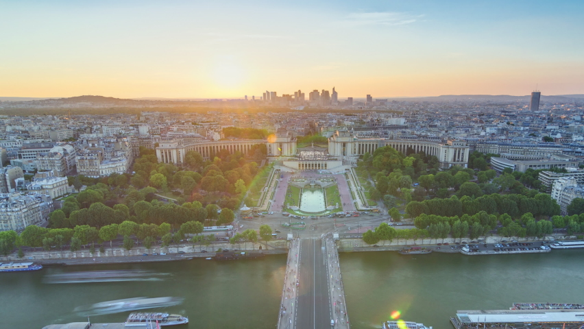 Sunset over Trocadero timelapse with the Palais de Chaillot seen from the Eiffel Tower in Paris, France. Top view from observation deck with river Seine and ship crossing it at summer day | Shutterstock HD Video #1070795296
