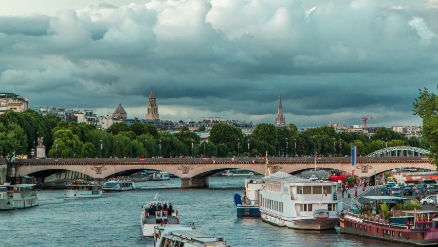Bridge of Jena day to night transition timelapse, which connects the Champ de Mars gardens and the Trocadero. Boat station on Seine River near Eiffel tower. View from Bir-Hakeim bridge. Cloudy sky at | Shutterstock HD Video #1070795329