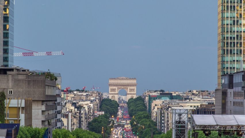 View from Grand Arch in Defense business district to the Arc de Triumph day to night transition timelapse. Illuminated skyscrapers and traffic on road. Paris, France | Shutterstock HD Video #1070795332
