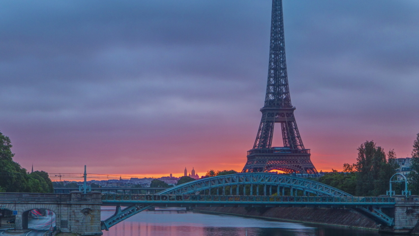 Eiffel Tower sunrise timelapse with boats on Seine river and in Paris, France. View from Grenelle bridge | Shutterstock HD Video #1070795455