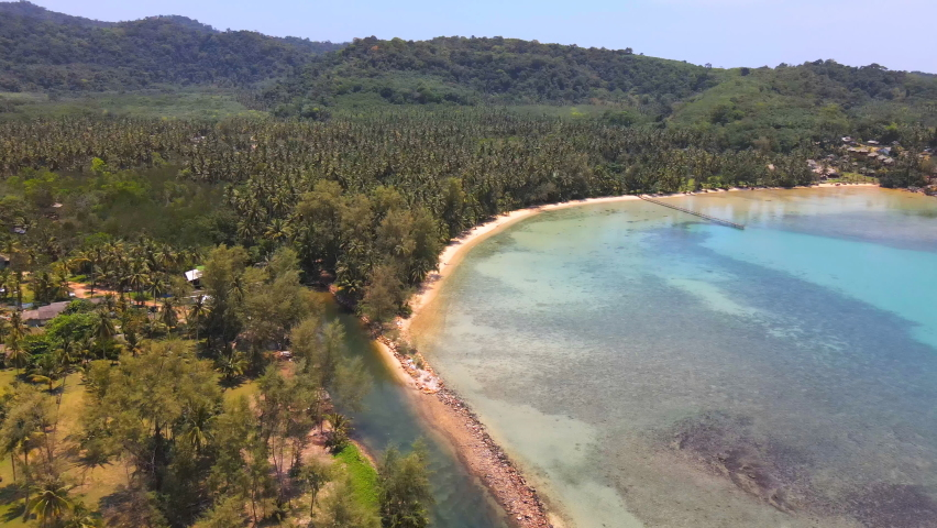 Aerial view of nature tropical paradise island beach enjoin a good summer beautiful time on the beach with clear water and blue sky in Koh kood or Ko Kut, Trat Thailand. | Shutterstock HD Video #1070796490