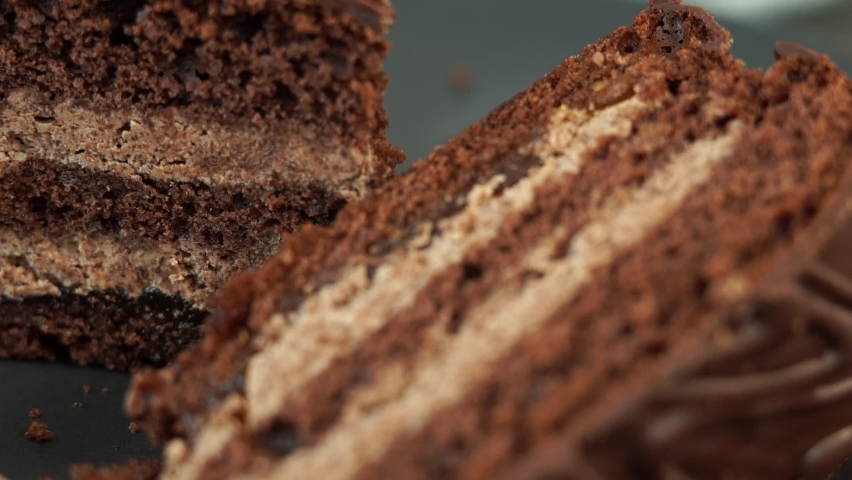 Camera movement on baked chocolate cake with nut filling. Close up of food dessert background. Bakery and pastry shop concept.   Shutterstock HD Video #1070797327
