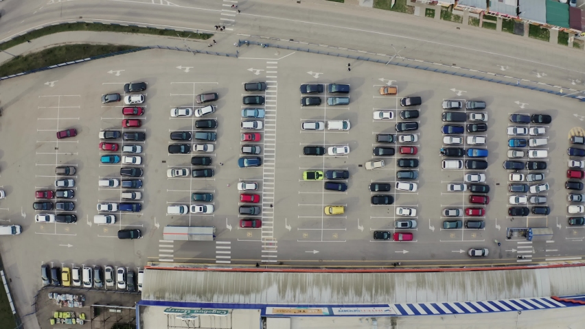 Aerial drone top view from drone of parking lot of the business center, shopping mall, supermarket with cars. | Shutterstock HD Video #1070798110