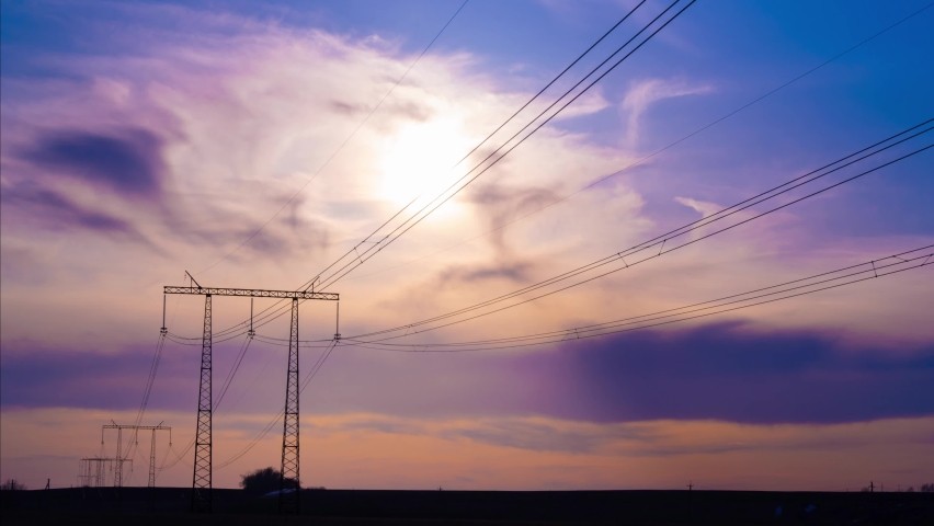 Timelapse of the sky at sunset against the background of an electric pole with wires | Shutterstock HD Video #1070802823