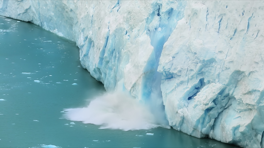 Los Glaciares National Park, Santa Cruz Province, Patagonia, Argentina. Natural beauty of towering glacier surrounded by glacial lake. A large mass of ice falls into the water. High quality 4k footage