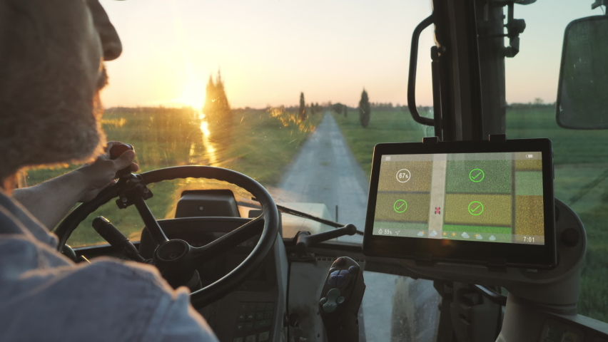 farmer male driving tractor uses smart display touch screen application to check the fields of the farm,agriculture new technology app onboard of agricultural machine,modern farmhouse startup Royalty-Free Stock Footage #1070854882