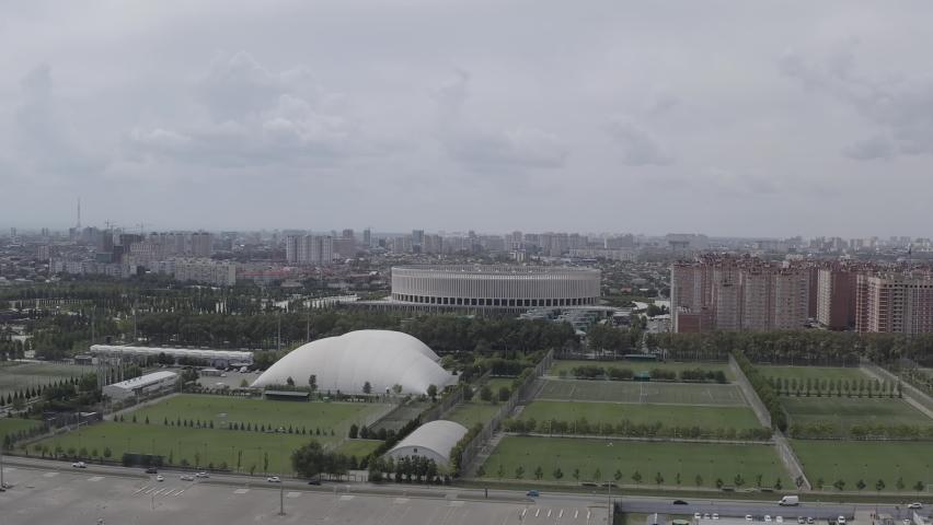 D-Log. Krasnodar, Russia - August 28, 2020: Krasnodar - football stadium of the eponymous club in the city of Krasnodar. Public Park Krasnodar (Galitsky Park). Summer aerial view, Aerial View