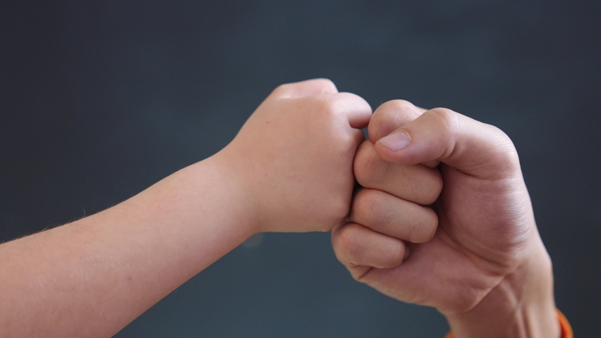 teamwork business concept. fist to fist commit solidarity a respect and brotherhood gesture. business kid team hands fists. happy family close-up partnership friendship teamwork. father and daughter Royalty-Free Stock Footage #1070890726