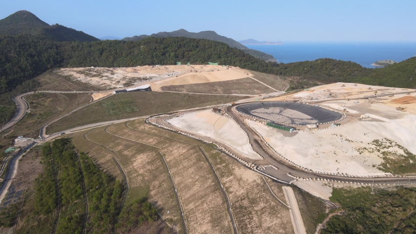 New Territories Land development and leveling and construction Landfill in Lohas Park,Tseung Kwan O of Hong Kong city, Kowloon Aerial Top view | Shutterstock HD Video #1070971243