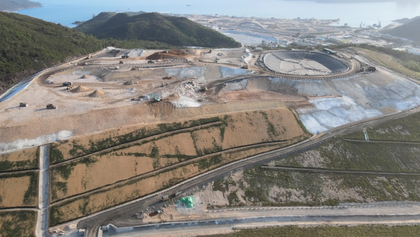 New Territories Land development and leveling and construction Landfill in Lohas Park,Tseung Kwan O of Hong Kong city, Kowloon Aerial Top view | Shutterstock HD Video #1070971249