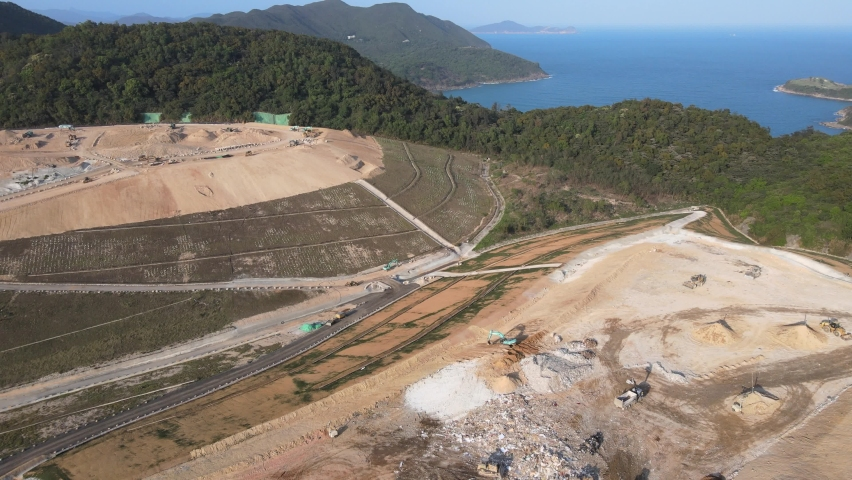 New Territories Land development and leveling and construction Landfill in Lohas Park,Tseung Kwan O of Hong Kong city, Kowloon Aerial Top view | Shutterstock HD Video #1070971264