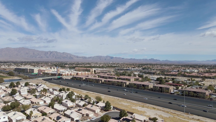 Aerial view of Summerlin Area with mountains in background and sky with striped clouds, Las Vegas | Shutterstock HD Video #1070983609