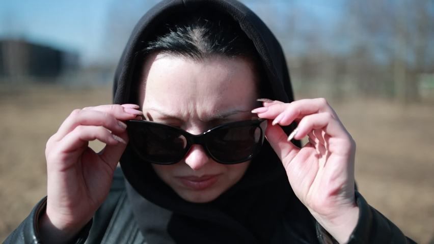 Portrait of a woman on a sunny day looking at the camera, slow motion video | Shutterstock HD Video #1071014527