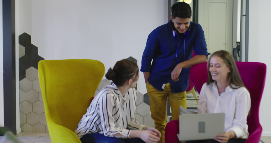 Multiethnic colleagues in a modern startup company having meeting | Shutterstock HD Video #1071015754