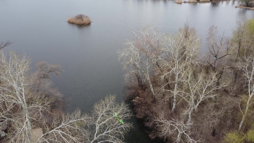 Rowing on a kayak drone shooting in dievskie floodplain 4K | Shutterstock HD Video #1071015835