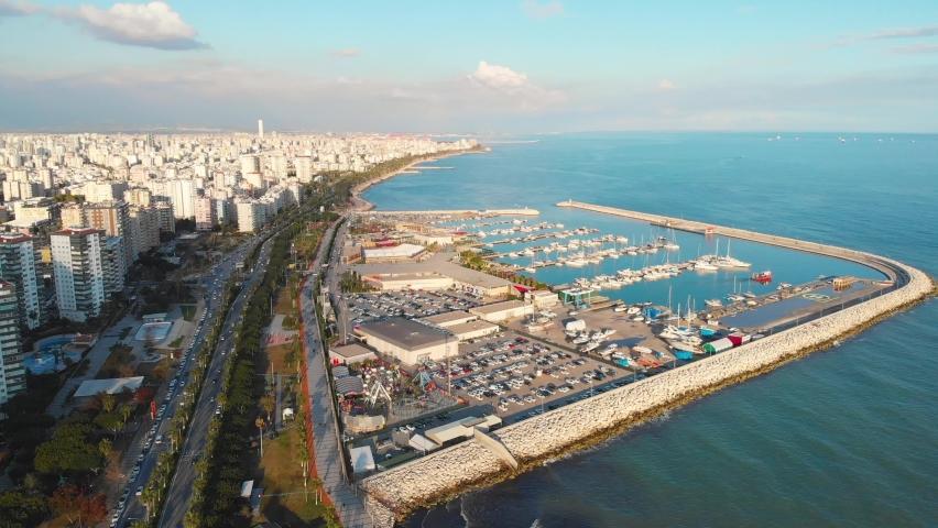 Aerial drone bird's eye view video of yachts and sailboats moored in Mersin Marina harbor on the Mediterranean coast, Mersin, Turkey. | Shutterstock HD Video #1071015874