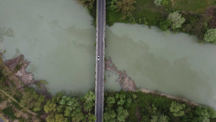 Aerial view of a bridge with cars . Slow rise froma Drone point of view. April 2021. | Shutterstock HD Video #1071016405
