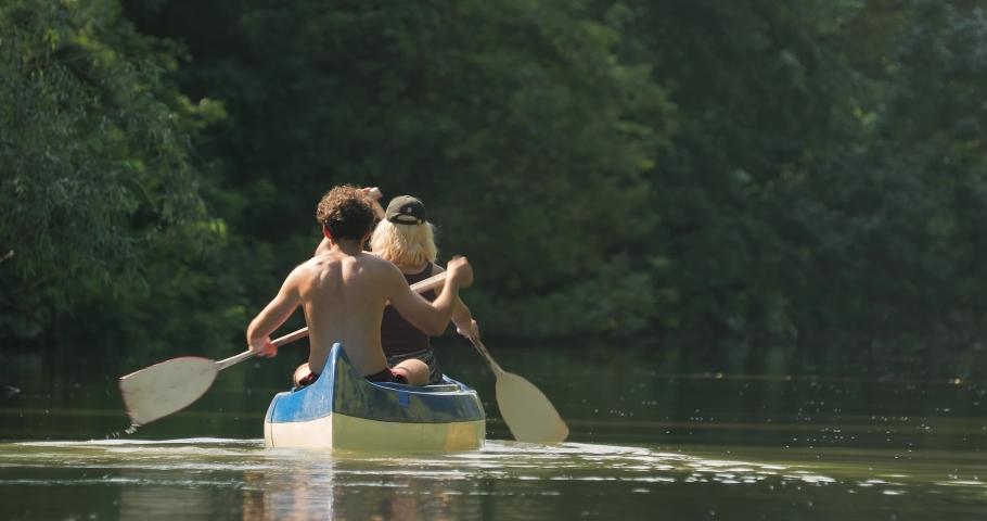 Canoeing ins ummer sunlight Tisza river passage, Lake Tisza, Hungary | Shutterstock HD Video #1071016591