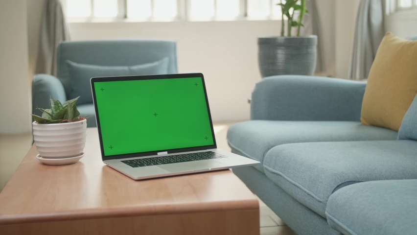 Laptop With Green Screen Display On Table At Home Living Room  | Shutterstock HD Video #1071016813