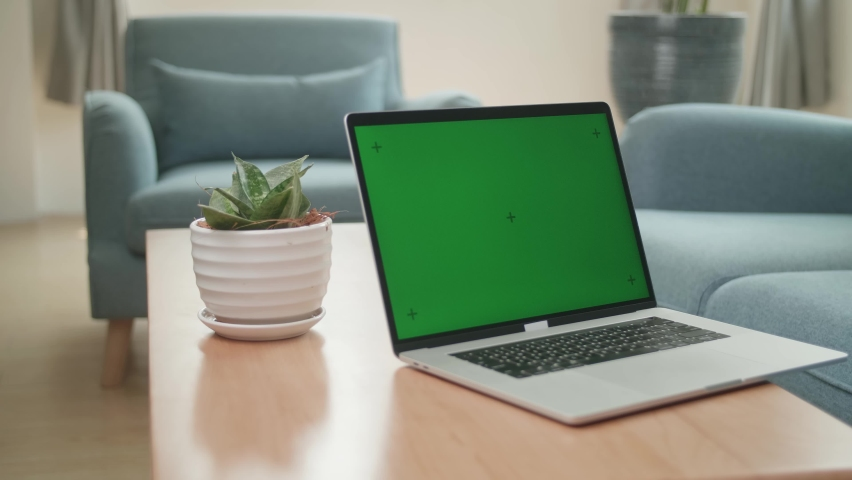 Laptop With Green Screen Mock Up Display At Home Living Room  | Shutterstock HD Video #1071016822