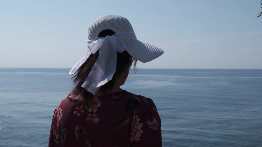 Young woman with white hat in a summer day going to the beach | Shutterstock HD Video #1071016936