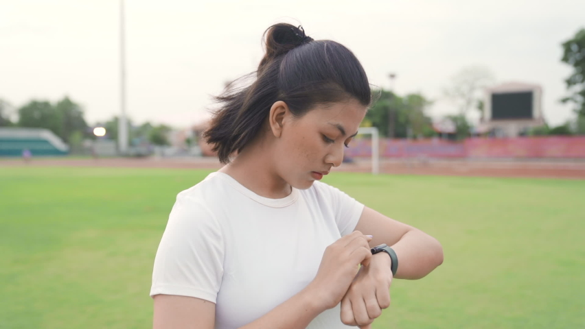 Woman setting up the fitness smart watch for running. Sportswoman checking watch device. | Shutterstock HD Video #1071017293