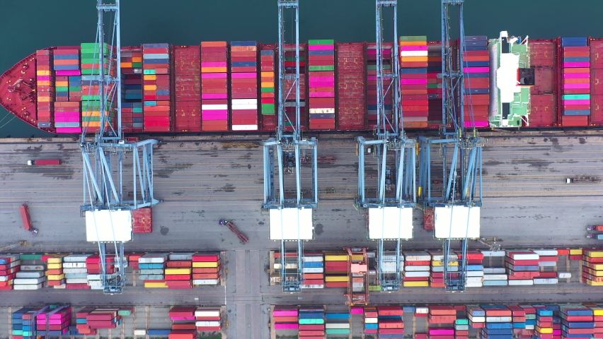 4 K - Aerial view of Cargo ship. Large container ship at industrial import-export port transport goods around world, global transportation and logistic business.Oversea international Business.  | Shutterstock HD Video #1071018061