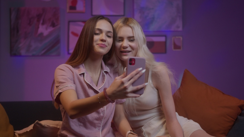 Happy young woman teenagers vloggers singing song, using phone making dancing video, speaking at camera webcam, video chat with online, selfie video call, talking record lifestyle vlog, young blogger | Shutterstock HD Video #1071018412