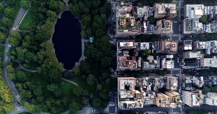 Aerial view of central park,  green lake, buildings and skyscrapers in New York during the day from done camera. Best New York aerial shot