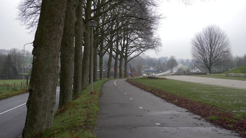 Bike path in holland. Winter landscape. Slow motion 4K   Shutterstock HD Video #1071138103