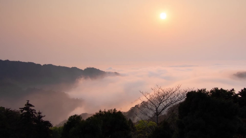 View of the sun through the mist at sunset at Taiwan.   Shutterstock HD Video #1071138712
