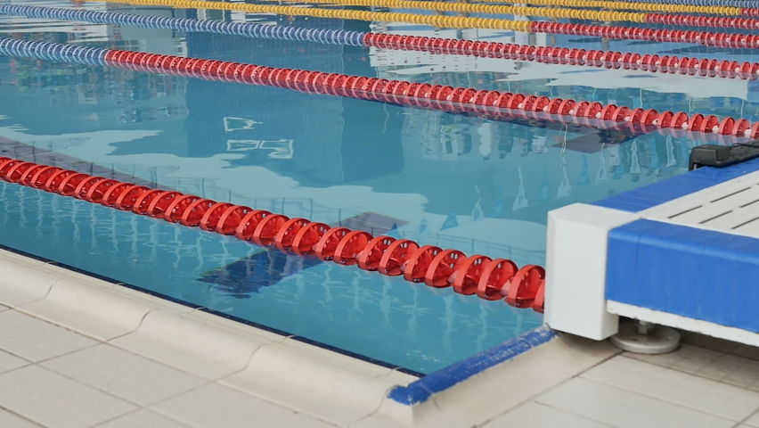 Start swimmers teenagers in the pool in the swimming competition. Slow motion | Shutterstock HD Video #1071139201