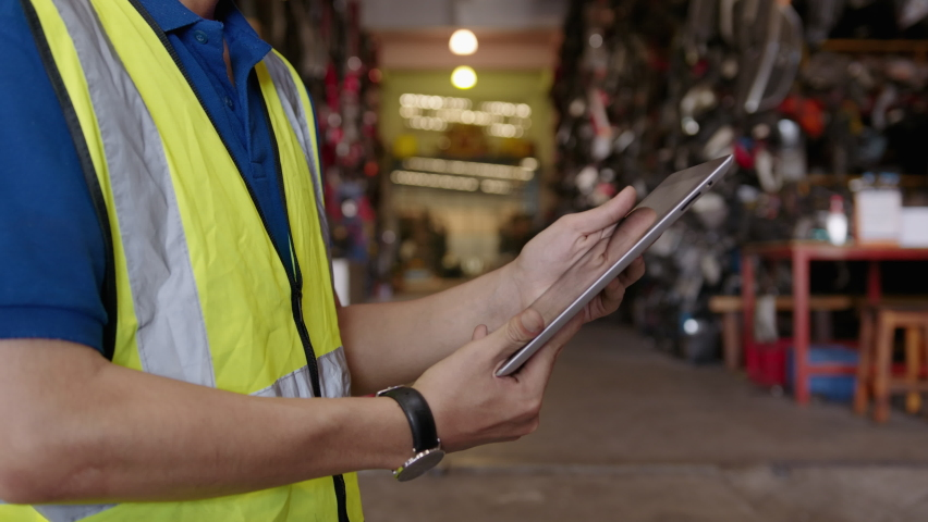 Close up engineering is using tablet in factory  | Shutterstock HD Video #1071139315
