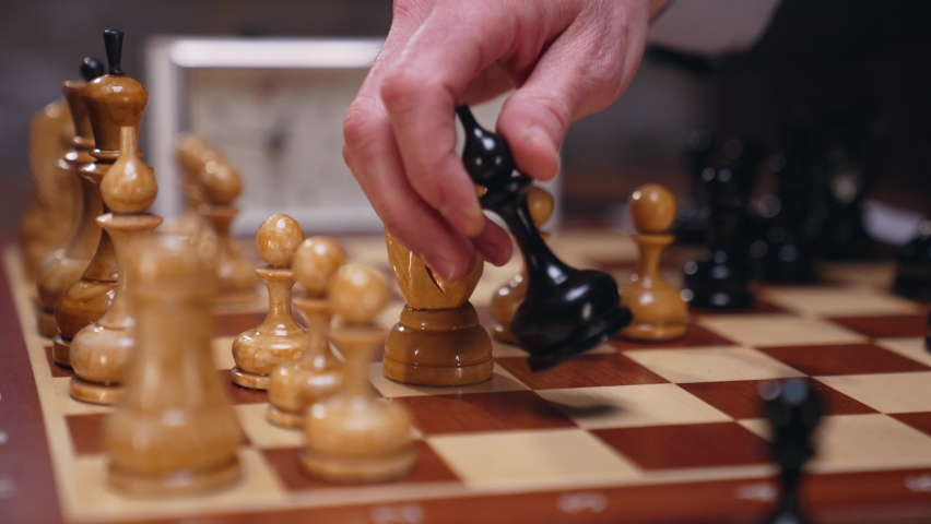Two chess players man and woman play chess. Debut Accepted Queen's Gambit, King's Gambit, Philidor's Defense. Cinematic filming of a chess game. Antique chess board. | Shutterstock HD Video #1071139540