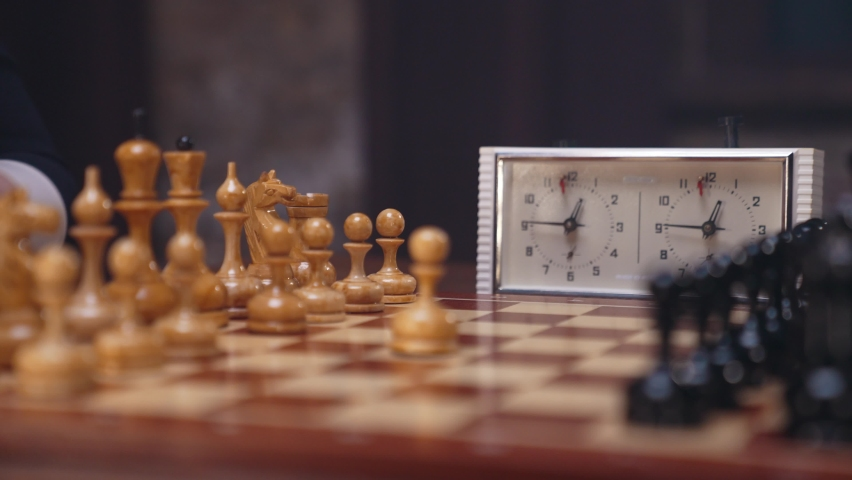 Two chess players man and woman play chess. Debut Accepted Queen's Gambit, King's Gambit, Philidor's Defense. Cinematic filming of a chess game. Antique chess board. | Shutterstock HD Video #1071139543