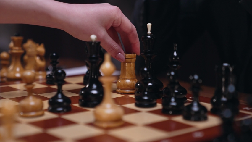 Two chess players man and woman play chess. Debut Accepted Queen's Gambit, King's Gambit, Philidor's Defense. Cinematic filming of a chess game. Antique chess board. | Shutterstock HD Video #1071139549
