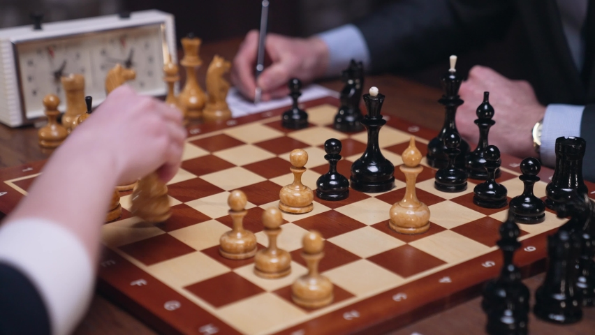 Two chess players man and woman play chess. Debut Accepted Queen's Gambit, King's Gambit, Philidor's Defense. Cinematic filming of a chess game. Antique chess board. | Shutterstock HD Video #1071139558