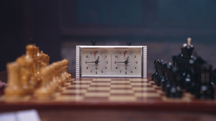 Two chess players man and woman play chess. Debut Accepted Queen's Gambit, King's Gambit, Philidor's Defense. Cinematic filming of a chess game. Antique chess board. | Shutterstock HD Video #1071139561
