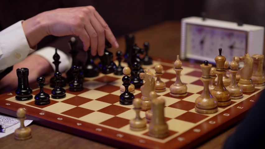 Two chess players man and woman play chess. Debut Accepted Queen's Gambit, King's Gambit, Philidor's Defense. Cinematic filming of a chess game. Antique chess board. | Shutterstock HD Video #1071139573
