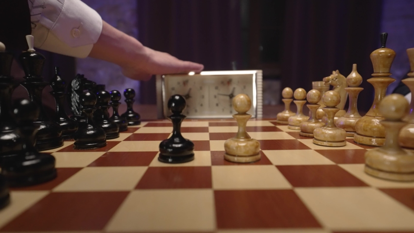 Two chess players man and woman play chess. Debut Accepted Queen's Gambit, King's Gambit, Philidor's Defense. Cinematic filming of a chess game. Antique chess board. | Shutterstock HD Video #1071139603