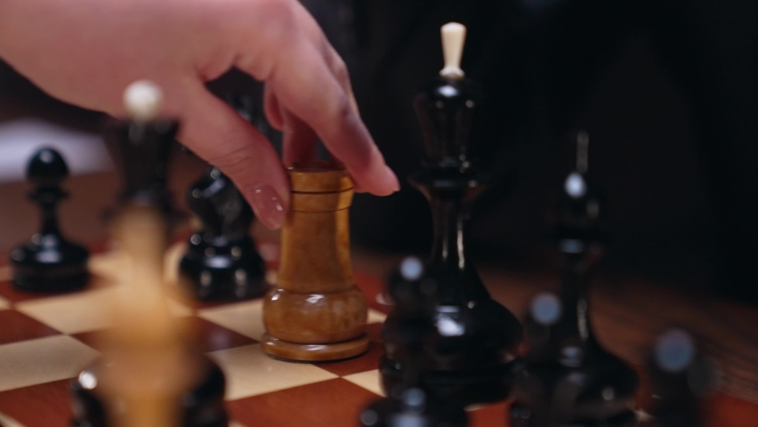 Two chess players man and woman play chess. Debut Accepted Queen's Gambit, King's Gambit, Philidor's Defense. Cinematic filming of a chess game. Antique chess board. | Shutterstock HD Video #1071139636