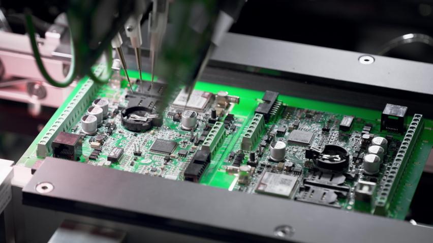 Machine for automatic testing of electronic boards. Manufacturing of microcircuits and microprocessors. Transistors are installed on a green board. The needles touch the microcircuit. Royalty-Free Stock Footage #1071140146