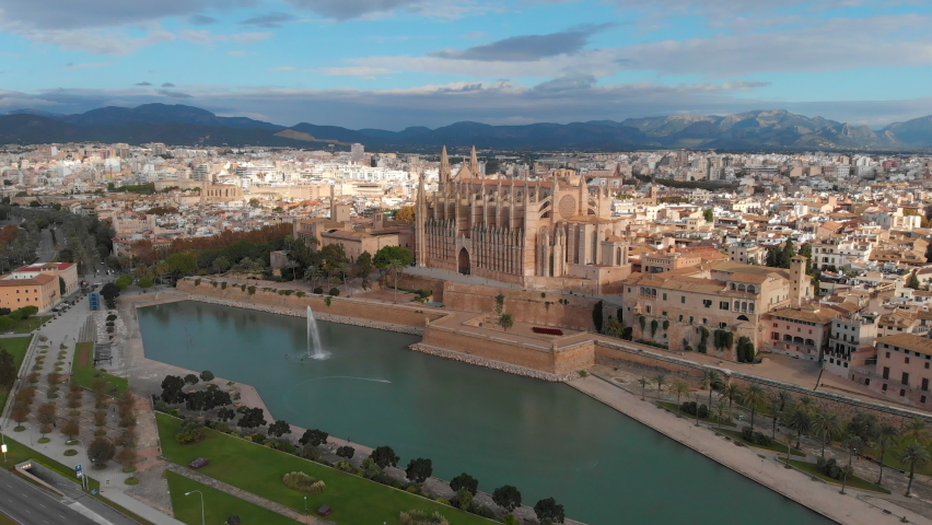 Palma de Mallorca cityscape. Cathedral La Seu of Santa Maria Royal Palace of La Almudaina, old architecture drone top point of view, sunny day. Travel, landmark, famous place. Balearic Islands. Spain | Shutterstock HD Video #1071140443