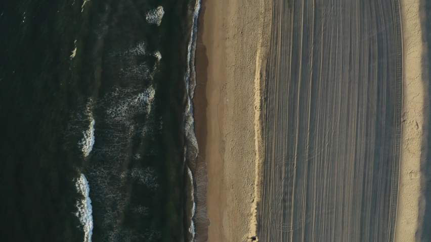 Aerial top down view going down shoreline | Shutterstock HD Video #1071142099
