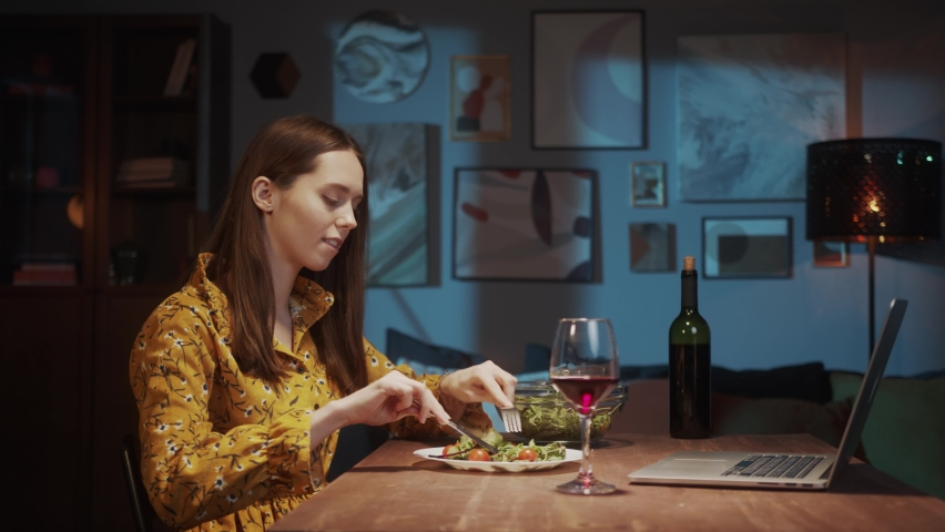 Romantic couple dinner online, Woman and man Online dating, using video chat conference call on laptop computer, lovers on long far distance during coronavirus covid 19 lockdown. | Shutterstock HD Video #1071142999